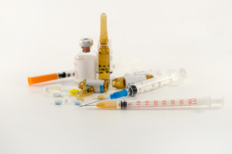Syringes and medicines on white background royalty free stock photography