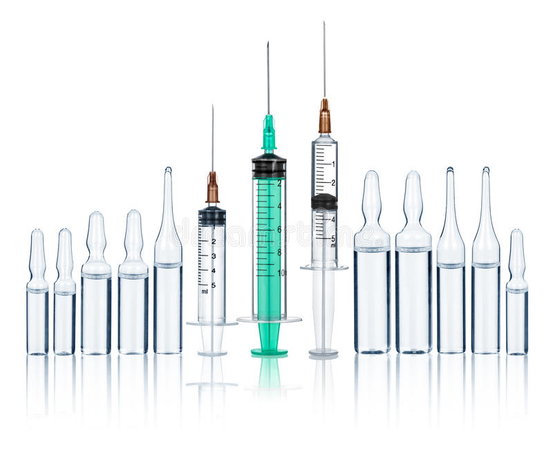 Syringes with needles and medical ampoules royalty free stock image