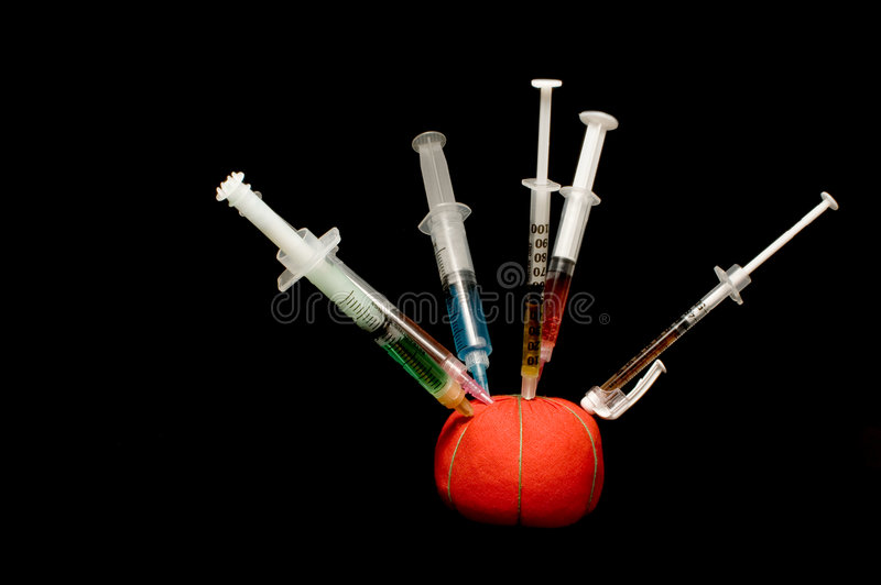 Download Syringes In A Pin Cushion Royalty Free Stock Image - Image: 5549706