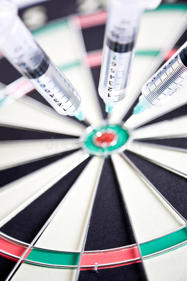 Download Syringes Stuck In A Dartboard Royalty Free Stock Photography - Image: 24561447