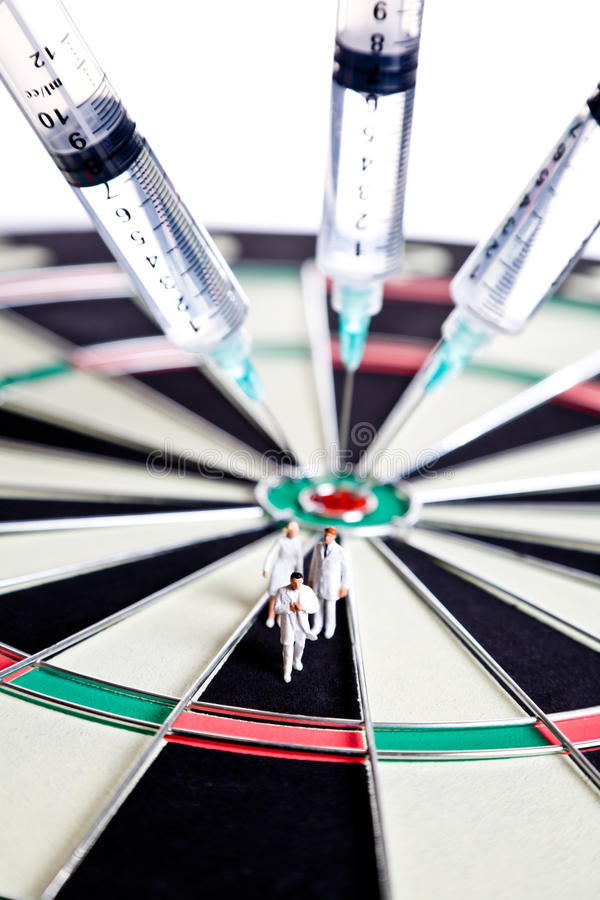 Syringes stuck in a dartboard with medical figures