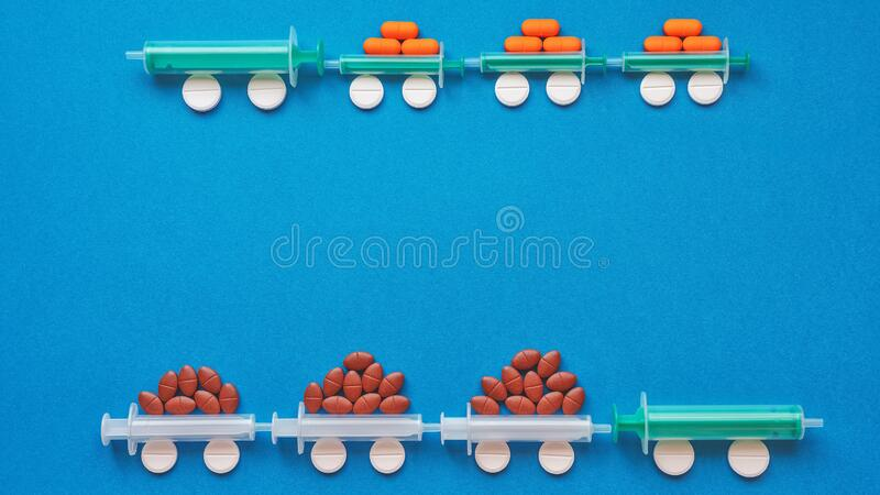 Syringes and tablets on a blue background. Medical concept royalty free stock photos