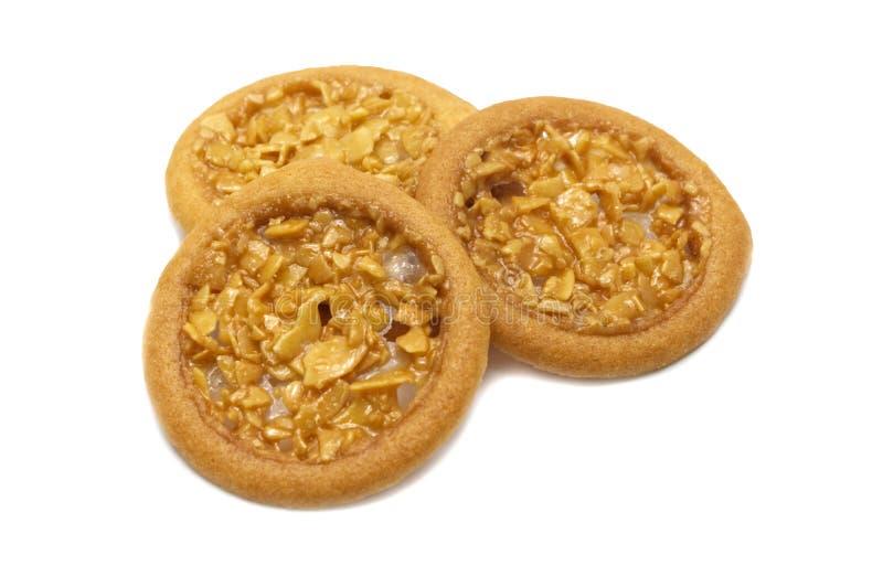 Syrliga och så söta smaksatta kakor för mandel arkivbild