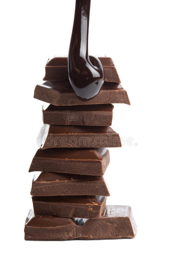 Download Syrup Being Poured Onto Chocolate Pieces Isolated Stock Photo - Image: 12953360