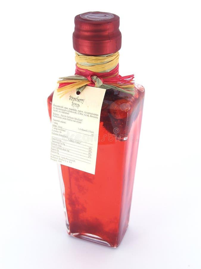 Syrup bottle. Sweet Strawberry jam jar studio shot royalty free stock photo