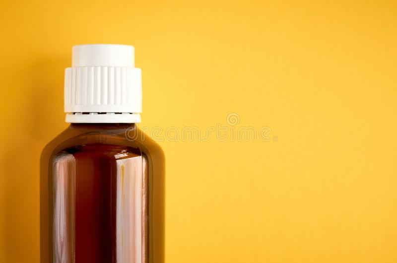 Syrup in glass bottle composition on yellow background. Flat lay and top view photo medicine cough health medical care illness liquid flu healthcare cold sick royalty free stock image