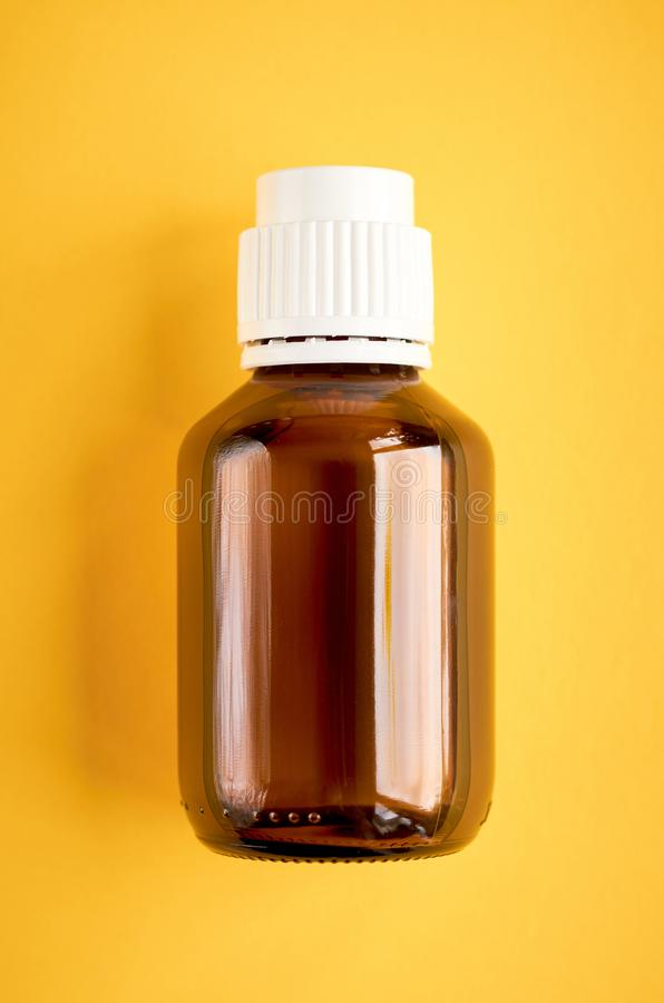 Syrup in glass bottle composition on yellow background. Flat lay and top view photo, medicine, cough, health, medical, care, illness, liquid, flu, healthcare royalty free stock image