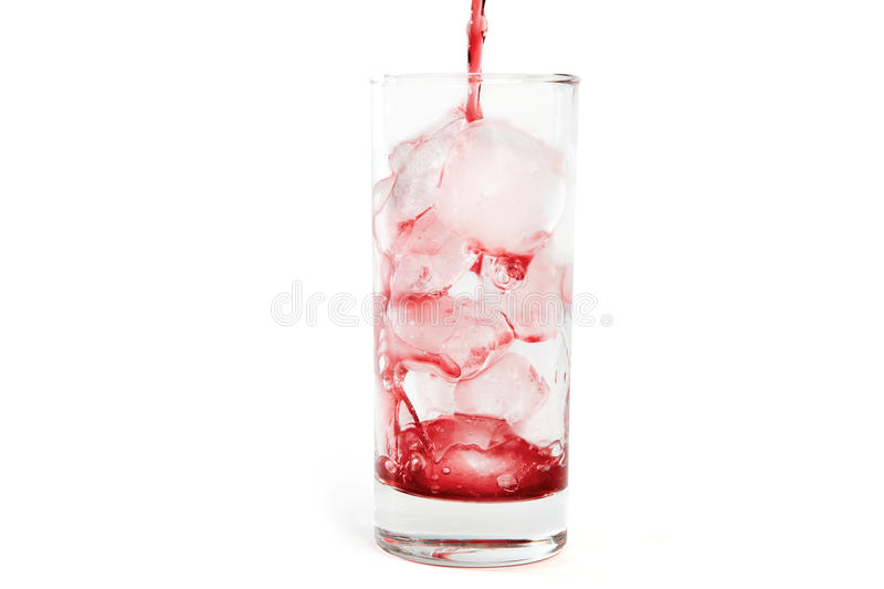 Syrup poured into glass with ice cubes royalty free stock photo