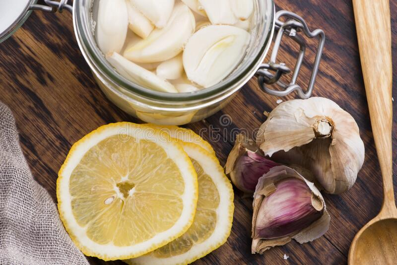 Syrup prepared from healthy garlic stock photos