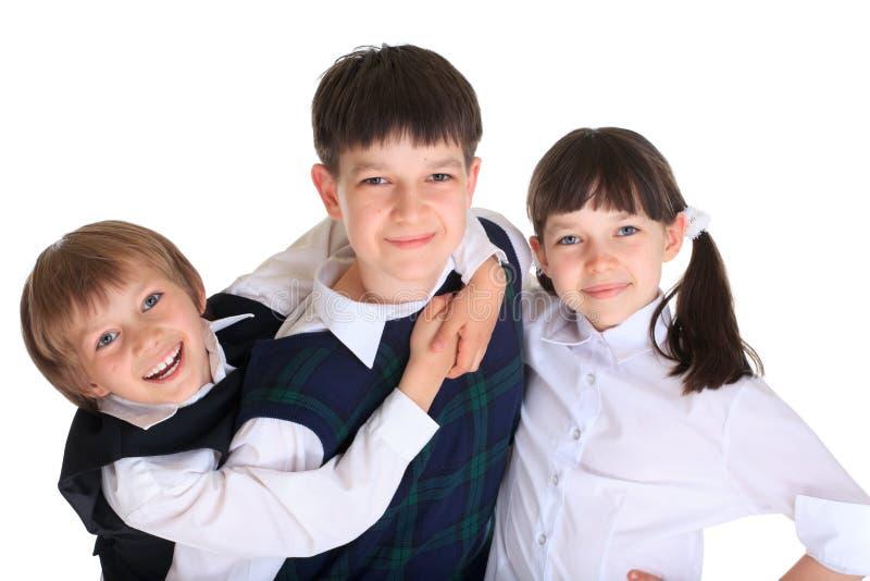 syskon tre barn arkivfoto