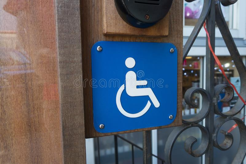 Sysmbol de la muestra de la accesibilidad de la silla de rueda imagen de archivo