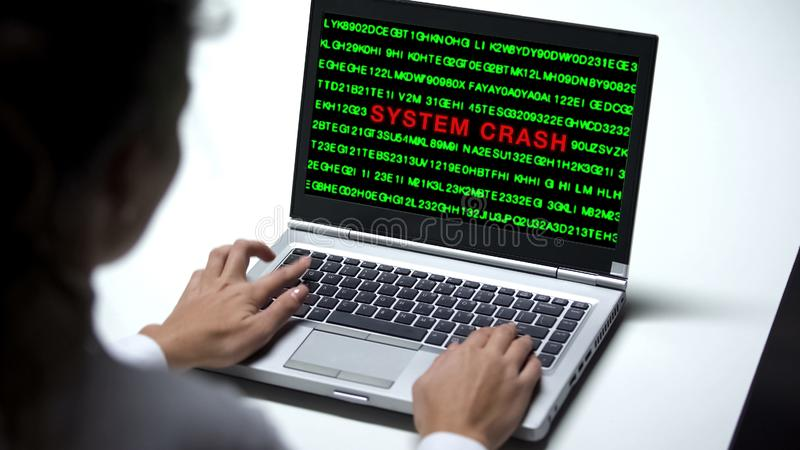 System crash on laptop computer, woman working in office, data hack, cybercrime. Stock photo royalty free stock image