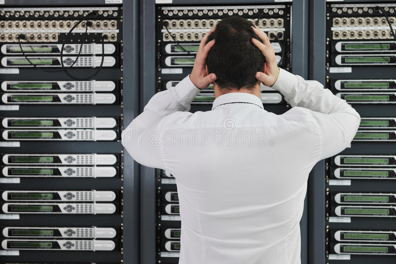 System fail situation in network server room. Business man in network server room have problems and looking for disaster solution