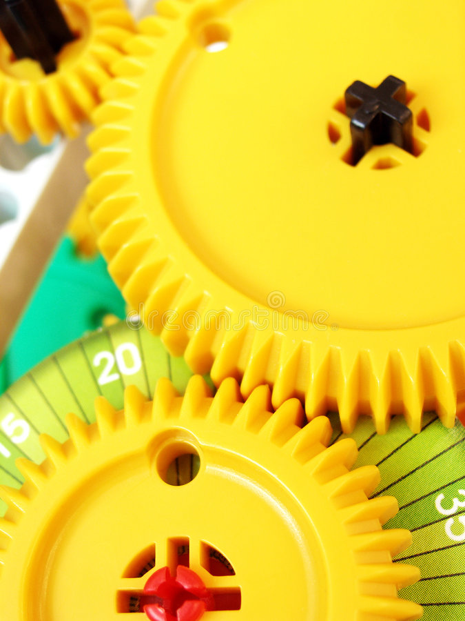 System of interconnected gears. Concept image for team work - An arrangement of two to three interlocking gears, assembled to show how a simple gear system or royalty free stock photo