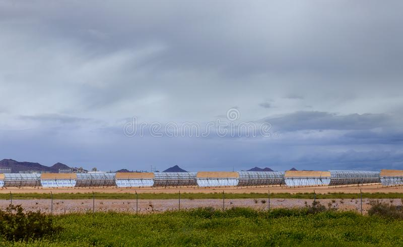 Systems for heating water from sunlight sun collectors on thermo electric station. Arizona desert solar renewable power energy electricity technology royalty free stock photography