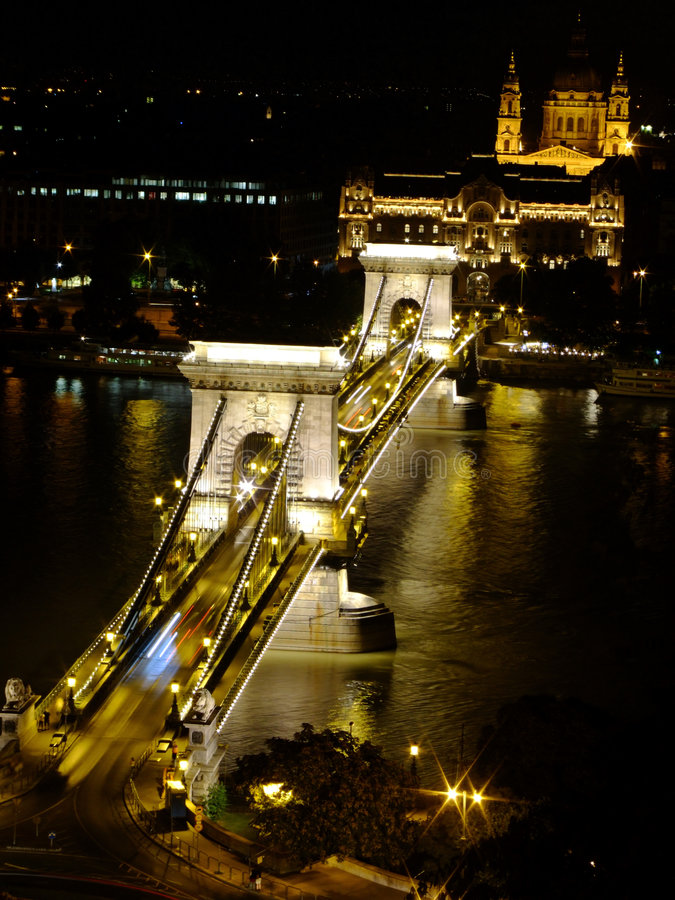 Széchenyi Chain Bridge in Budapest by night. The bridge was designed by the English engineer William Tierney Clark in 1839, after Count Istvan Széchenyi's stock image