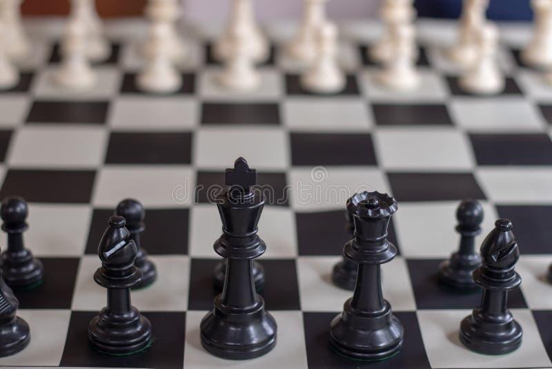 Szachowy początkujący zbliżenia czerni królewiątko i królowa fotografia royalty free