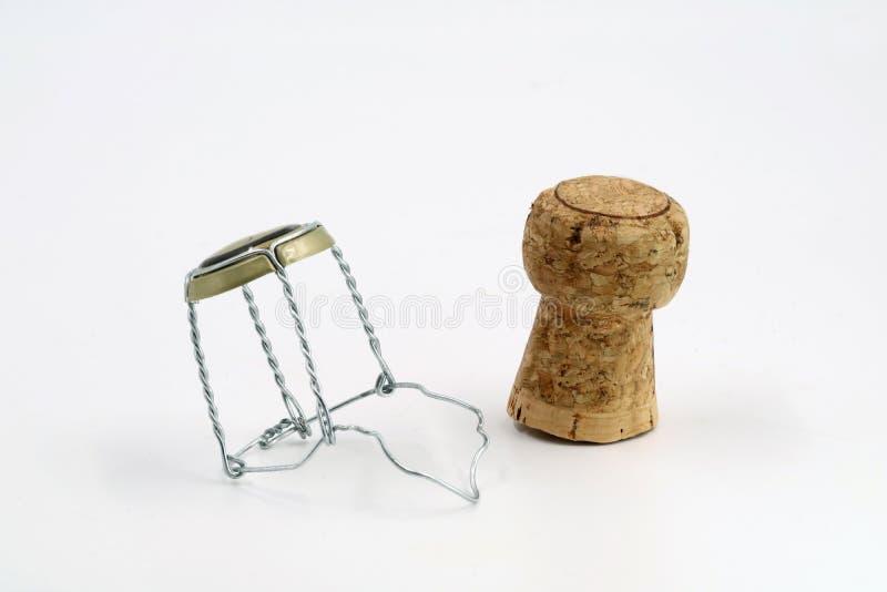 Szampana korek z drucianym koszem odizolowywającym na bielu zdjęcia stock