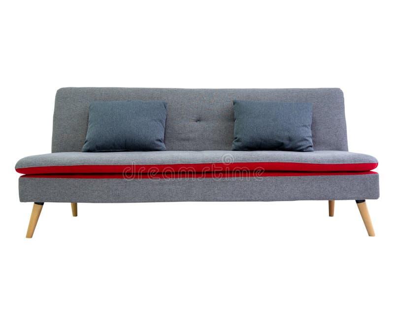 Szara czarna nowożytna wygodna kanapa w żywym izbowym mieszkaniu z biel ścianą Meble dekoruje projekt odizolowywającego na b obrazy stock