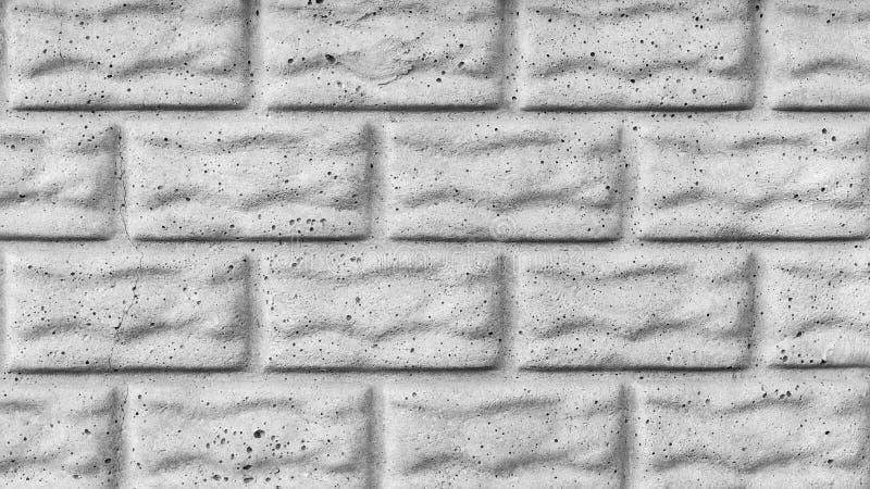 Szara tekstura betonowa ściana z pęknięciami, imitacja kamieni bloki lub cegły, architektura abstrakta tło zdjęcia stock
