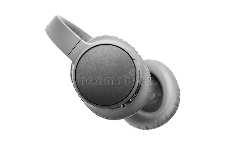 Szare słuchawki bezprzewodowe na białym tle wyizolowane z bliska, duży, szary zestaw słuchawkowy bluetooth, nowoczesne, czarne sł fotografia stock