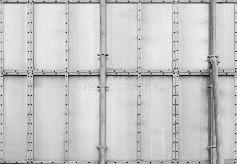 Szarego metalu przemysłowy panel. Tło tekstura zdjęcie stock