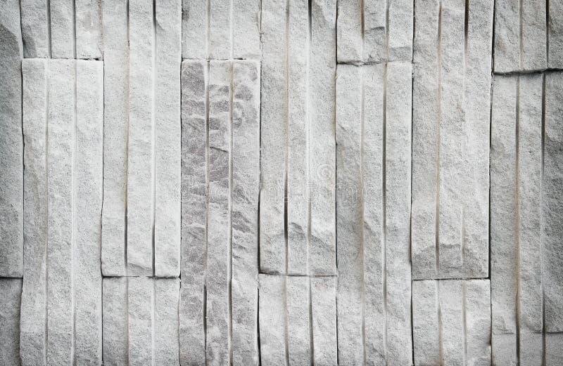 Szarej piaskowcowej ściany z cegieł tekstury dekoracyjny, miękki kolor dla tła w pionowo wzorach zewnętrzny, obraz stock