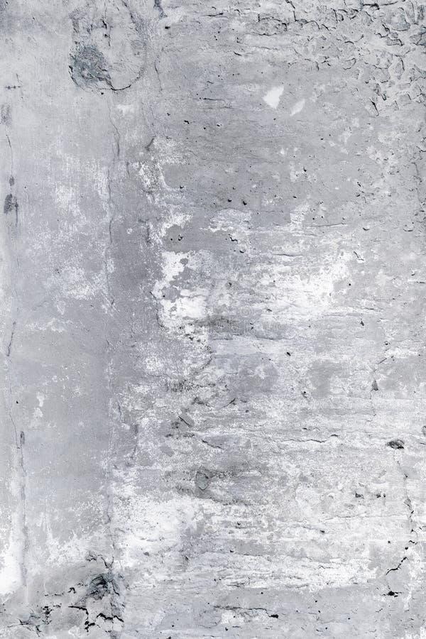 Szarość brudzą betonową ścianę z pęknięciami i punktami Tło z teksturą fotografia royalty free