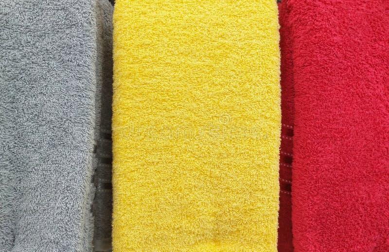 Szarość, koloru żółtego i Czerwonego koloru tkaniny ręcznikowy tło, zdjęcia stock