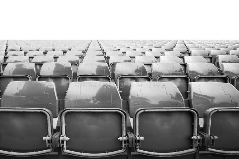 Szarość opróżniają krzesła w stadionie futbolowym dla siedzenia dopatrywania meczów piłkarskich obraz royalty free