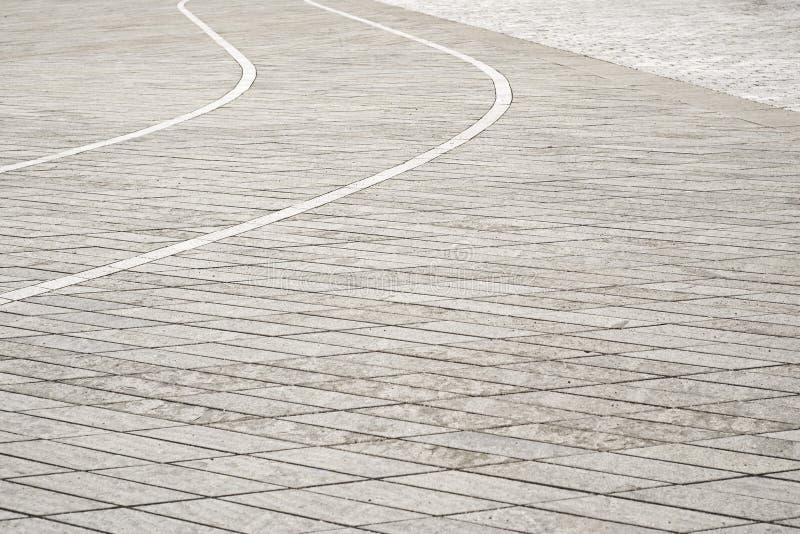 Szarości kafelkowy podłogowy tło stary kwadratowego miasta zdjęcia royalty free