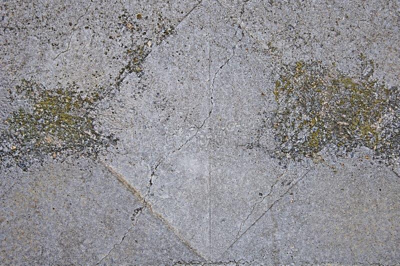 Szarości tekstury betonowy tło pęknięcia zdjęcia stock