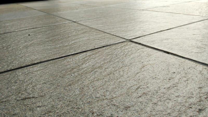 Szary dachówkowych podłoga tło obrazy stock