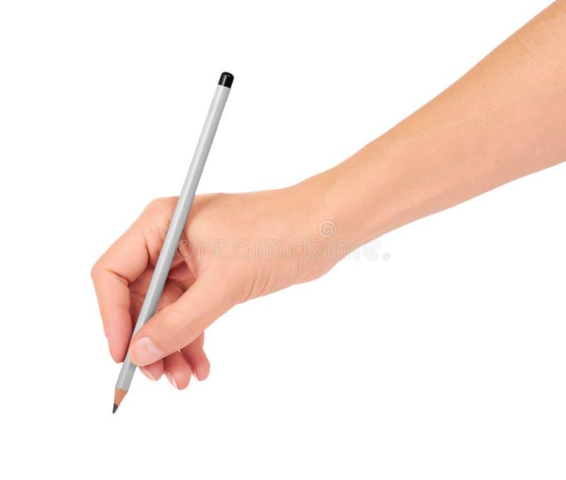 Szary ołówek w ręce dla rysować odizolowywam na białym tle obrazy stock