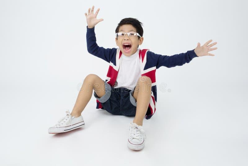 Szczęśliwa azjatykcia śliczna chłopiec z uśmiech twarzą obraz stock