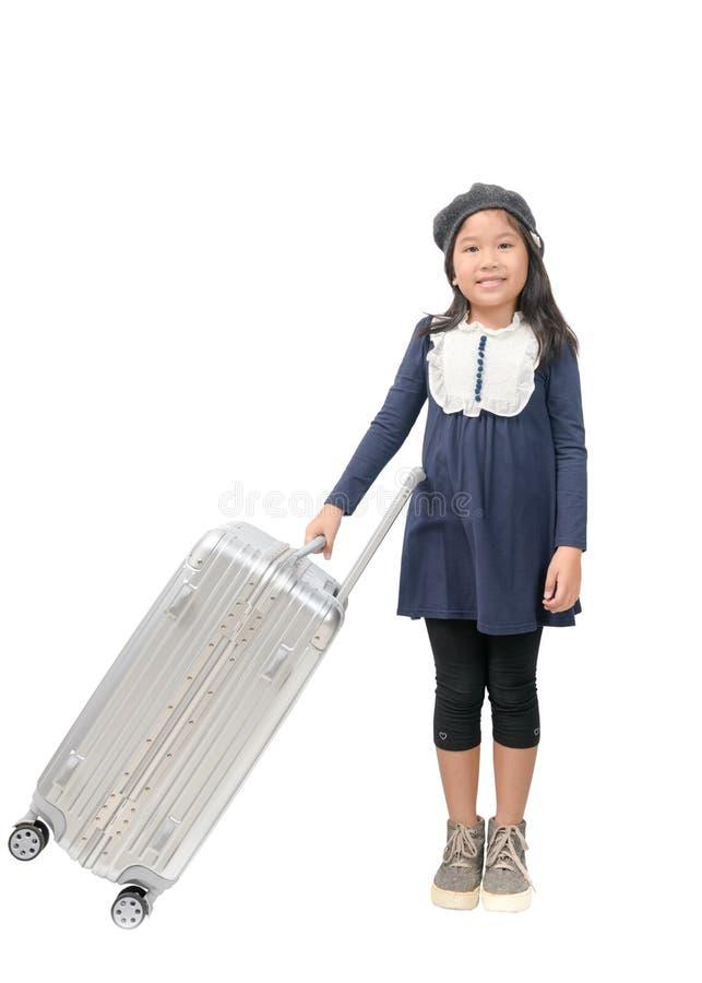 Szczęśliwa azjatykcia dziewczyna trzyma dużego bagaż odizolowywający fotografia stock
