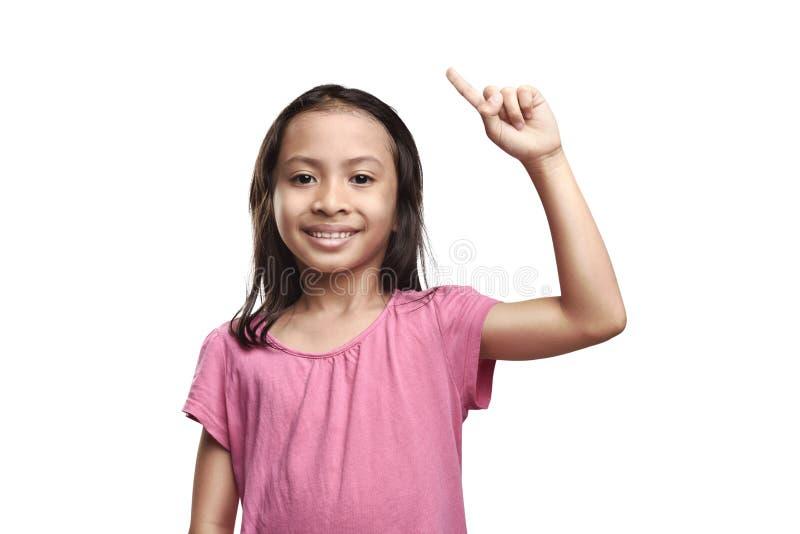 Szczęśliwa azjatykcia mała dziewczynka ma dobrego pomysł obraz stock