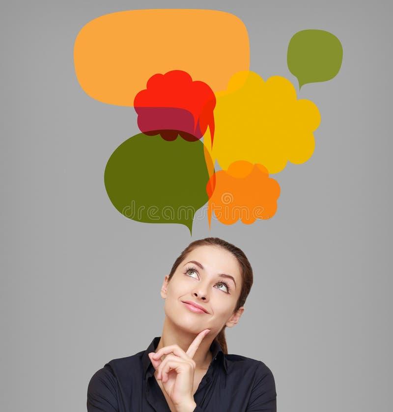 Szczęśliwa biznesowa kobieta patrzeje na wiele kolorowych bąblach fotografia royalty free