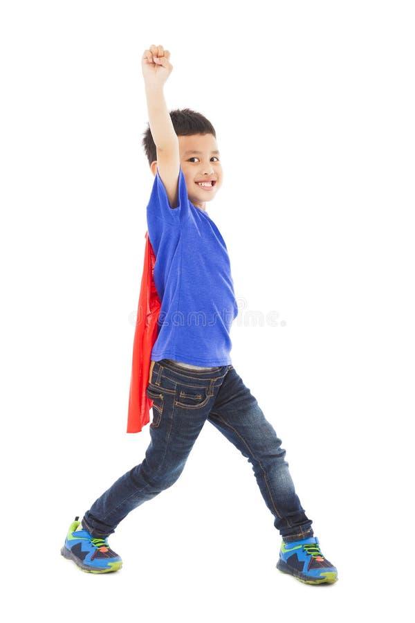 Szczęśliwa bohatera dzieciaka bohatera podwyżki ręka fotografia royalty free