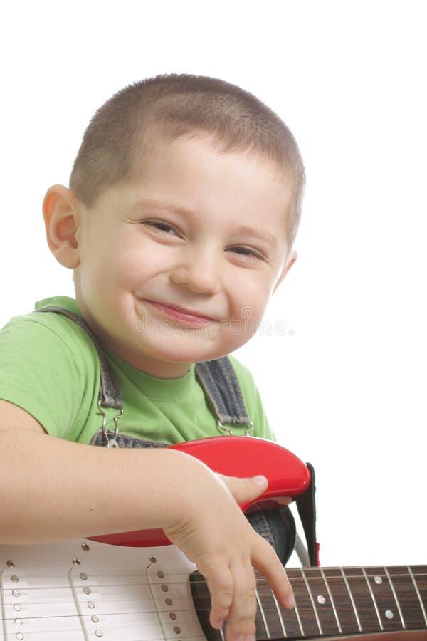 szczęśliwa chłopiec gitara obrazy stock
