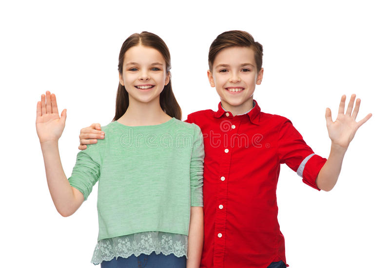 Szczęśliwa chłopiec i dziewczyny falowania ręka fotografia royalty free