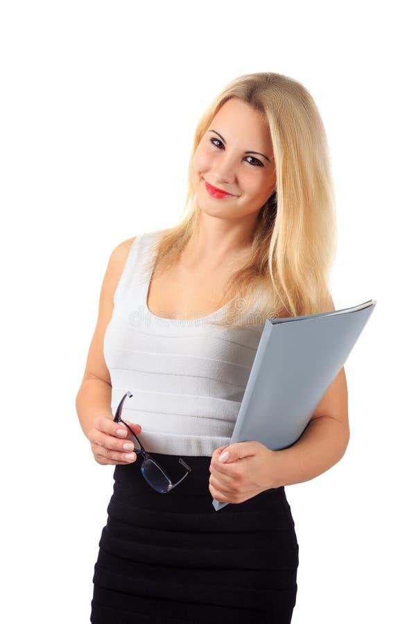 Szczęśliwa dziewczyna w biznesowych stroju i szkieł chwytach siwieje falcówkę obrazy stock