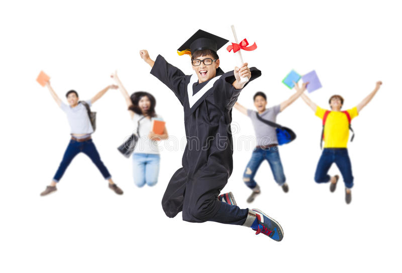 Szczęśliwa grupa skacze wpólnie w magisterskim kontuszu obraz royalty free