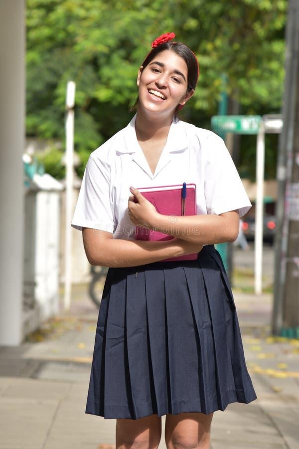 Szczęśliwa Katolicka Kolumbijska osoba Jest ubranym mundur zdjęcie stock