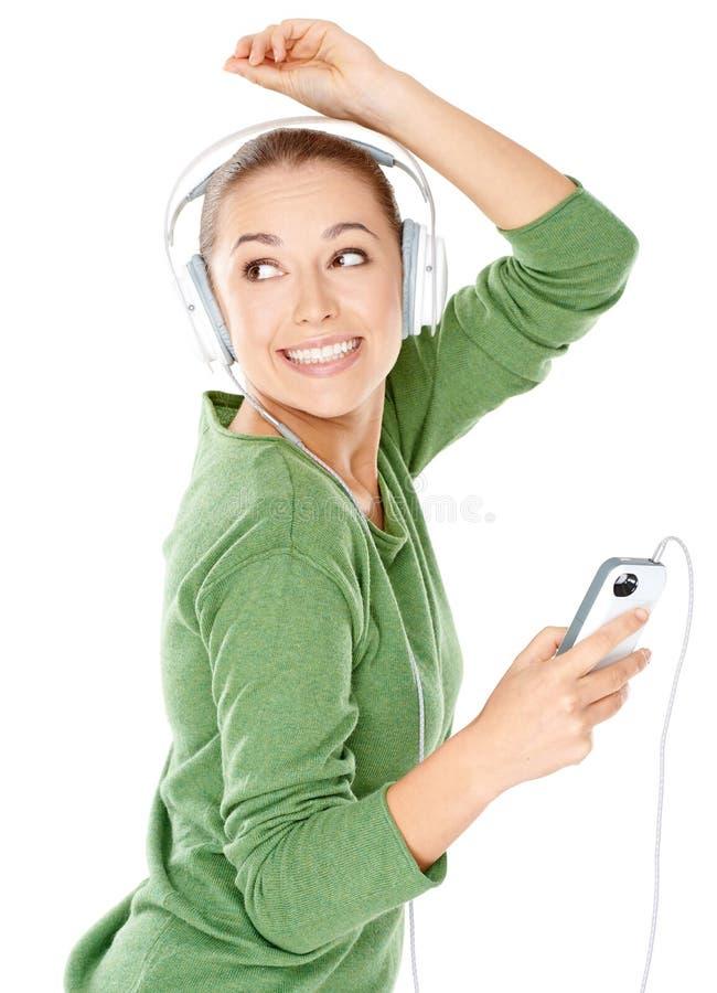 Szczęśliwa kobieta tanczy jej muzyka zdjęcia stock