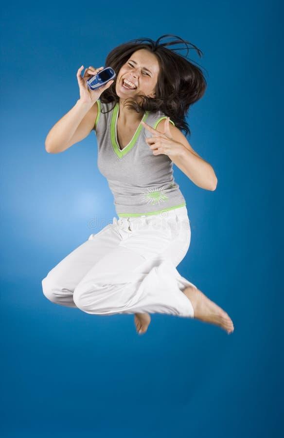 szczęśliwa kobieta telefonu komórki obraz royalty free