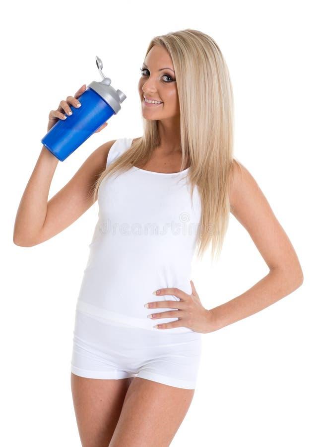 Szczęśliwa kobieta z sporta odżywianiem. zdjęcie stock