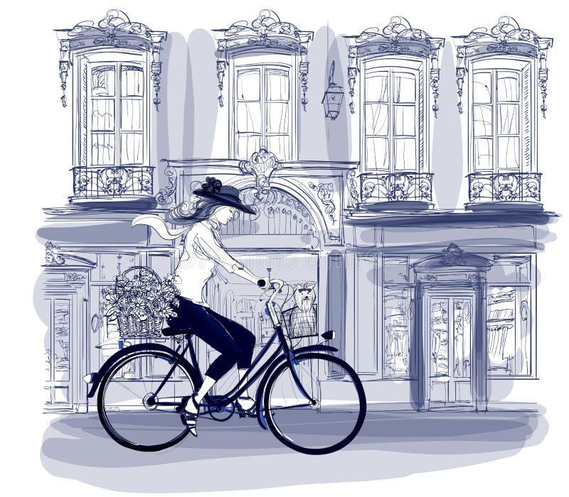 Szczęśliwa młoda bicyclist jazda w ulicie w Paryż z troszkę ilustracji