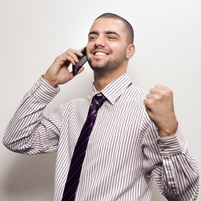 Szczęśliwa młoda biznesowego mężczyzna odświętność fotografia stock