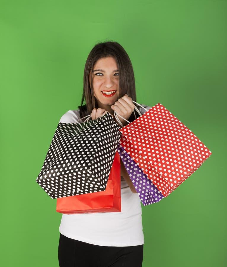 Szczęśliwa młoda dziewczyna po robić zakupy zdjęcie stock